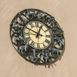 Wall clock with figurines zodiac signs — Stock Photo