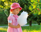 Child with cotton candy — Stock Photo