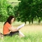 Girl reading a book — Stock Photo #27710223