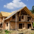 Unfinished, ecological wooden house and building area. — Stock Photo