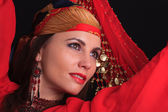 Woman traditional dancer wearing red dress isolated on white bac — Stok fotoğraf