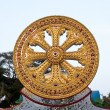 Wheel of Dhamma, symbol of Buddhism — Stock Photo