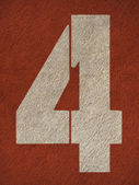 Números na pista de corrida vermelho — Fotografia Stock
