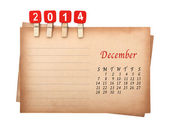 Calendar 2014 on the old paper with wooden pegs — Photo