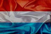 Luxembourg grunge waving flag — Stock Photo