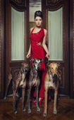 Pretty woman in red dress — Stock Photo