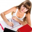 Stock Photo: Cute teen girl homeschooling with books and tablet isolated over