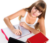 Cute teen girl homeschooling with books and tablet isolated over — Stock Photo