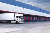 Truck and warehouse — Stock Photo