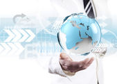 Businessman holding world map — Stock Photo