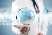 Businessman holding world map — Stockfoto