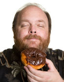 Man with chocolate donut — Stock Photo