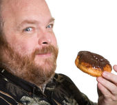 Man med chocolate donut — Stockfoto