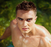 Young attractive man staying in the sea — Stock Photo