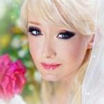 Very beautiful blonde in a wedding dress. — Stock Photo