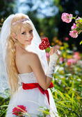 Very beautiful blonde in a wedding dress. — Stock Photo