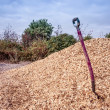 Shovel in mulch — Stock Photo