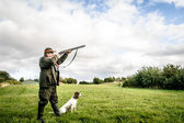 Hunter aiming — Stock Photo