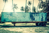 Old grunge truck in tropical inviroment — Stock Photo