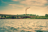 Bridge construction by the lake — Stock fotografie