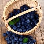 Blueberries in wooden basket — Stock Photo #15704693