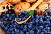 Blueberries on wooden spoon — Stock Photo
