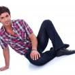 Handsome guy sitting on the floor — Stock Photo #16084245