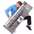 Enthusiastic keyboard player — Stock Photo #20054005