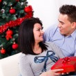 Lovers at Christmas eve — Stock Photo
