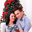 Happy couple at Christmas day — Stockfoto