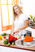 Blonde woman in kitchen — Stock Photo