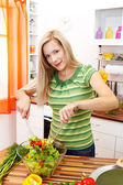 Pretty woman making salad — Stock Photo