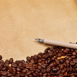 Coffee beans, parchment and pen — Stock Photo