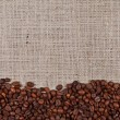 Coffee on burlap — Stock Photo
