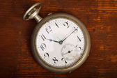 Pocket watch on wood table — Stockfoto