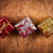 Gift boxes on wood background — Stock Photo