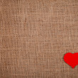Red heart on burlap — Stock Photo
