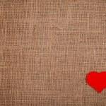 Red heart on burlap — Stock Photo