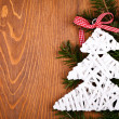 Little white Christmas tree on juniper leaves — Stock Photo