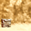 Small golden giftbox — Stock Photo