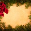 Claret bow on old paper, Christmas decoration — Stock Photo