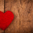 String red heart on wooden background — ストック写真