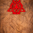 Small red Christmas tree on wooden background — Lizenzfreies Foto