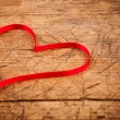 Ribbon heart on wooden table — Stock Photo