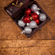 Treasure box with Christmas globes — Stock Photo