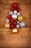 Christmas tree made of ornaments — Stock Photo