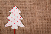 Little Christmas tree with spots — Stock Photo
