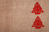 Two Christmas trees on burlap — ストック写真