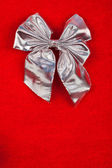 Silver ribbon on velvet background — Stock Photo