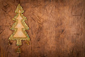 Christmas tree decoration with three bell on wood table — Photo